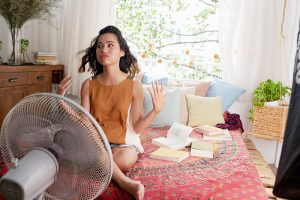 girl cool off with a fan